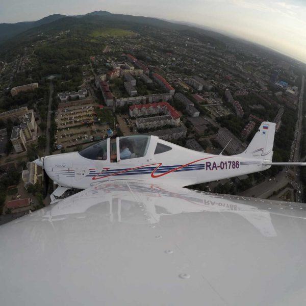 Полёт на самолёте над Артёмом