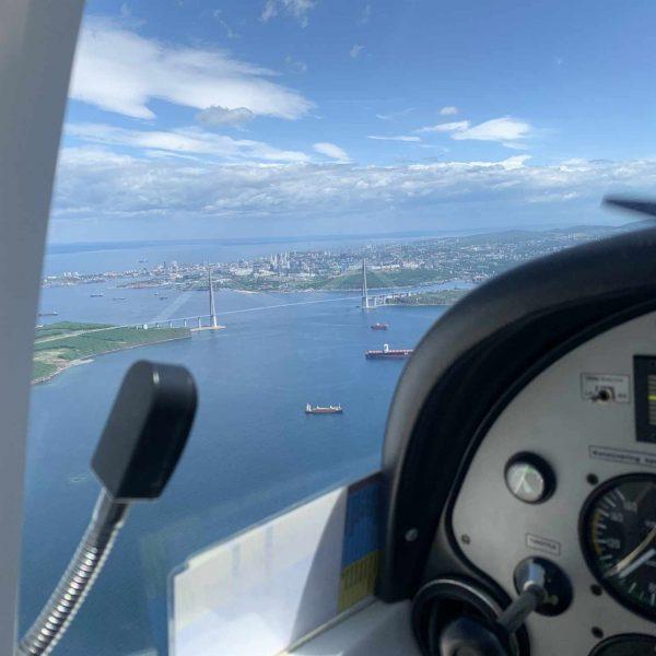 Полёт на самолёте над Уссурийским и Амурским заливом
